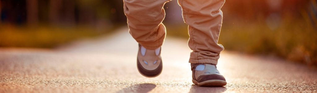Baby feet walking on a path